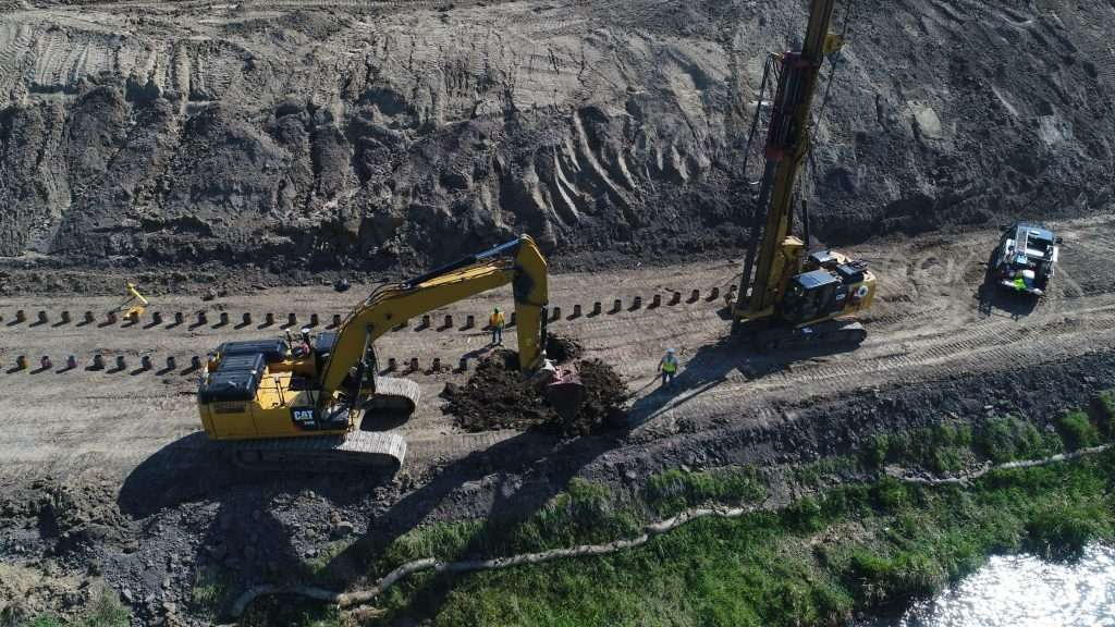 One of RPI Construction Equipment's CZM EK125HH pile driving rig rentals sits on soil to start the piling job