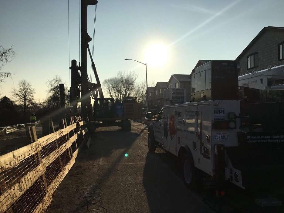 A crew of construction contractors are servicing a piling project onsite with pile driving equipment rentals from RPI
