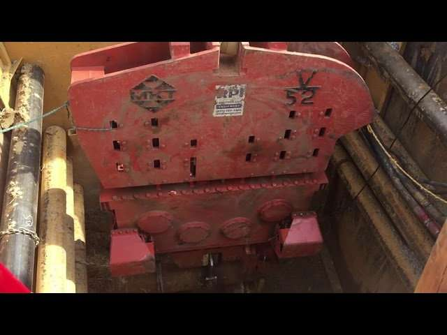 """MKT V-52 Vibratory Hammer shaking a 16"""" pipe in a trench Video"""